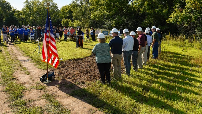 A group of people gathered for the official groundbreaking for the new St. Cloud Tech High School Monday, Aug. 28, near 33rd Street South.