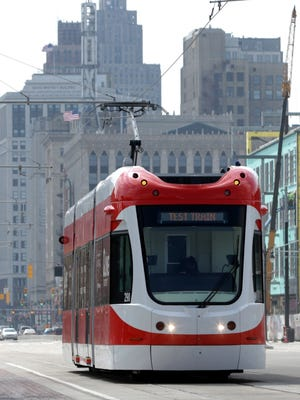 The QLine heads north on Woodward passing by the Little Caesars Arena that will be the new home to the Detroit Red Wings and Detroit Pistons.One month from now the QLine officially starts taking passengers from Midtown to downtown and back.On Tuesday, April 11, 2017 as it has with the past several days and weeks the QLine has been doing test runs up and down Woodward Avenue in Detroit, Michigan.