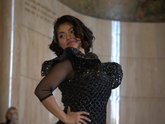 Griselda Puga wears a dress made from cassette tape
