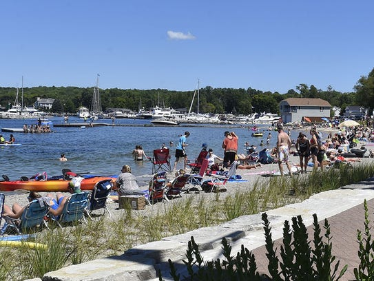 The beach at Waterfront Park in Sister Bay was bustling