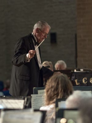 Richard Bradstreet conducts the 50-member Lee County Community Band, next in concert on  Sunday.