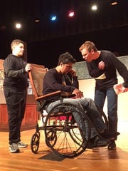 "Ian Hannah as Potter's goon, Danny Loya as Mr. Potter, and Levi Langolf as Uncle Billy rehearse for  Frank Capra's ""It's A Wonderful Life – The Musical"" opening Dec. 8 at Wilson Memorial High School."