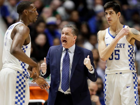 FILE - In this Saturday, March 11, 2017, file photo, Kentucky head coach John Calipari talks to Edrice Adebayo (3) and Derek Willis (35) in the first half of an NCAA college basketball game against Alabama in the semifinals of the Southeastern Conference tournament in Nashville, Tenn. Long considered a football power, the Southeastern Conference is showing some basketball promise. The league has a chance to get three teams in the Elite Eight of the NCAA Tournament, with Kentucky, Florida and South Carolina playing in the Sweet 16 on Friday night. (AP Photo/Wade Payne, File)