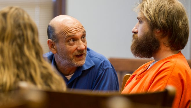 Defense attorney John Bruzek talks with Flannery Kennedy-Meier during a competency hearing in the Johnson County Courthouse on Friday, July 6, 2018.