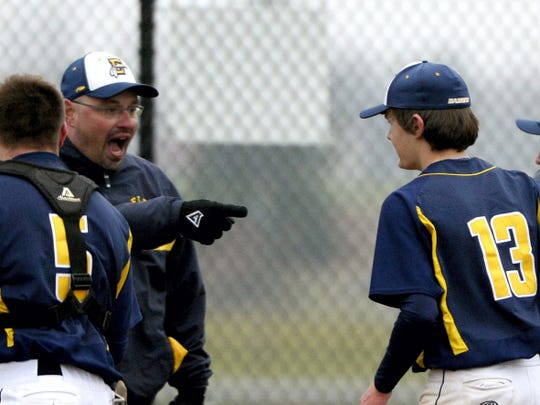 Elco coach Chris Weidner congratulates pitcher Cole Blatt after a regular-season game last year. Blatt will be atop the Raiders' rotation this spring.