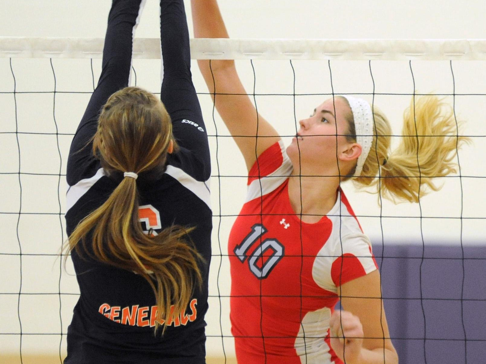 Westfall's Hannah Phillips (10) spikes the ball against West Lafayette Ridgewood's Amanda Lowery during a 2013 postseason game. Phillips will be a front runner for SVC Player of the Year this fall.
