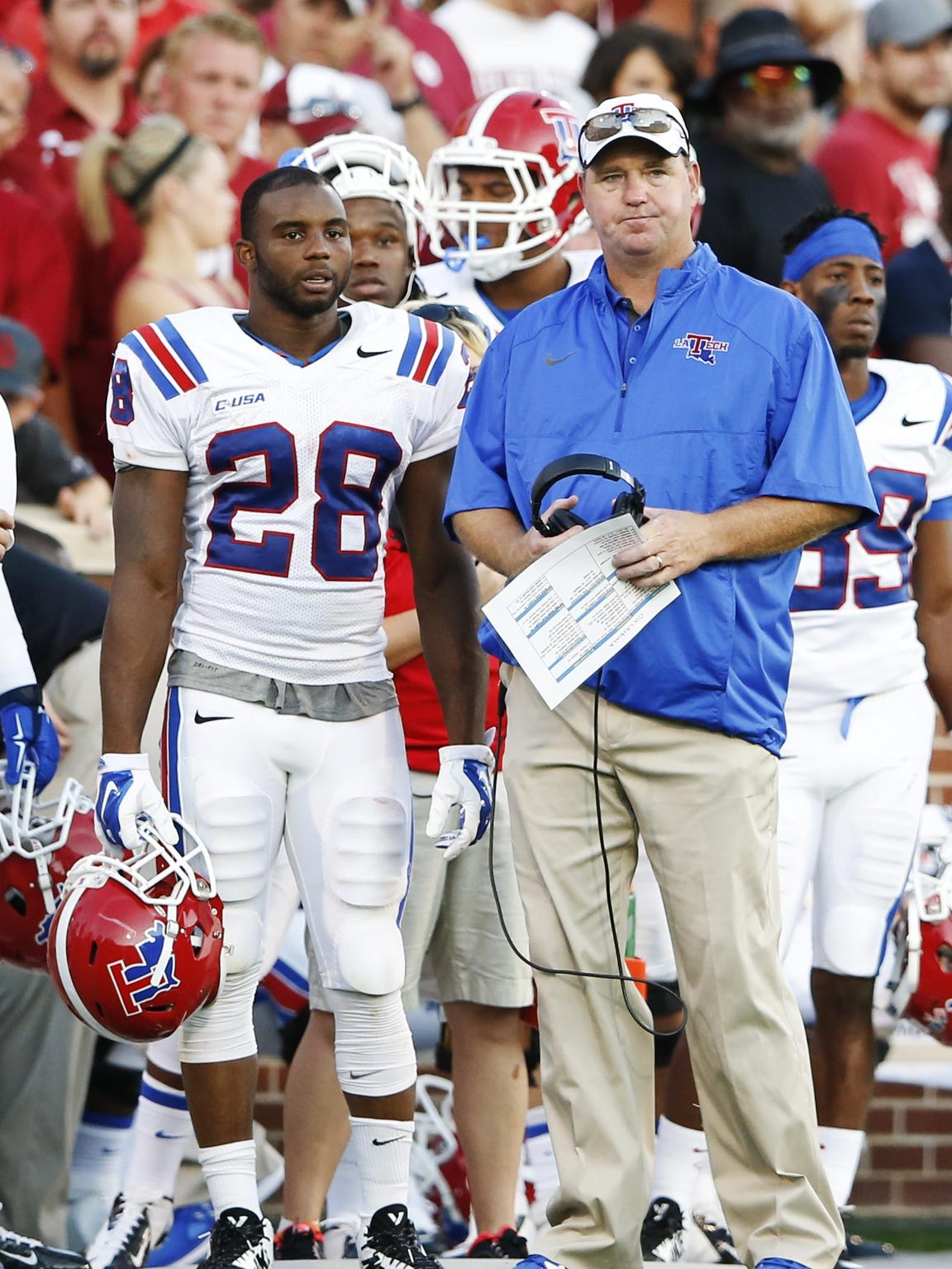 Running back Kenneth Dixon, shown with Tech coach Skip
