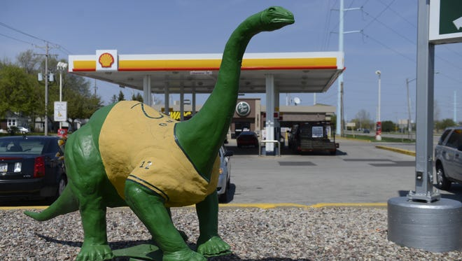 The well-known dinosaur at the corner of Lombardi and Ashland avenues is the basis for rebranding of Wied Oil properties as Dino Stops.