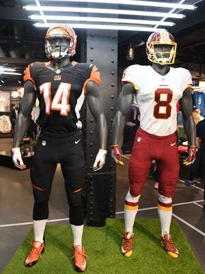 Mannequins with the helmets and uniforms of Cincinnati Bengals quarterback Andy Dalton and Washington Redskins quarterback Kirk Cousins on display at Niketown London.