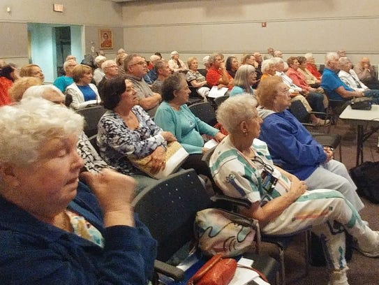 Indivisible members listen to William Thar, MD, MPH,