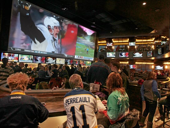 A packed house of hockey loving patrons watch hockey