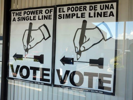 A bilingual sign at the Monterey County Elections Office