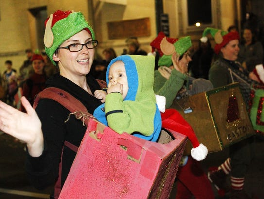 People march in the downtown Staunton Christmas Parade.