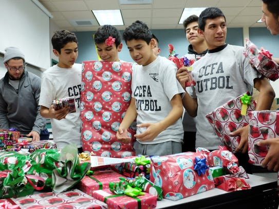 Kids from the CCFA help with the holiday toy drive every December that has helped more than 600 families receive presents for the holiday season.