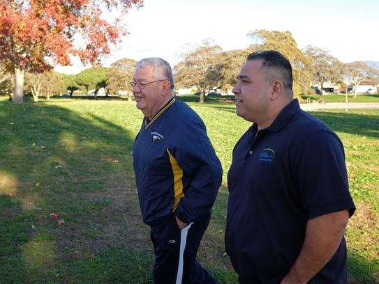 George Grimm, left, and Freddy Fuentes take in the