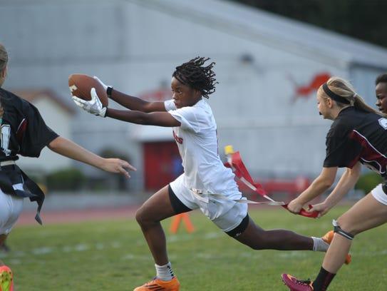 Florida High's Janae Scott runs for a first down against
