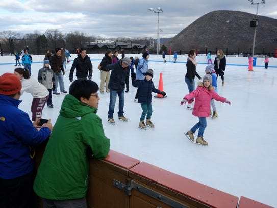 Skaters enjoy the outdoor ice rink at Bear Mountain