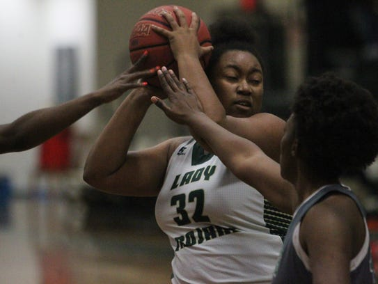 Lincoln senior Lillie Walker grabs a rebound in the