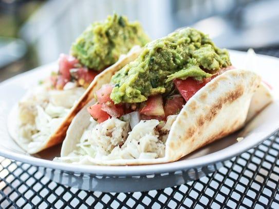 Chipotle fish tacos, with tilapia, pico de gallo, guacamole,