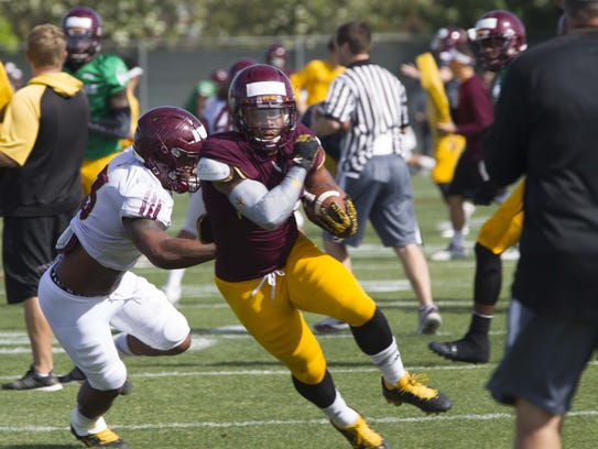 ASU Football player Demario Richard (4) practices with