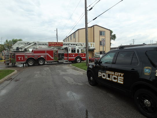 Iowa City Police and Fire vehicles line the scene of