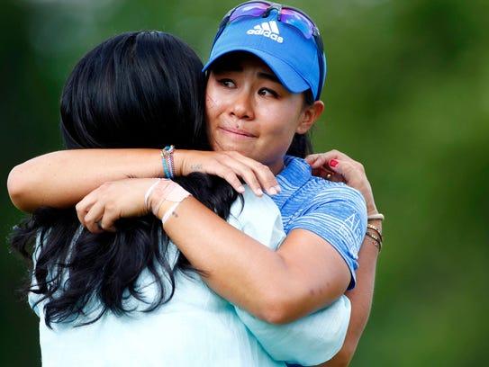 Westlake High graduate Danielle Kang embraces her mom