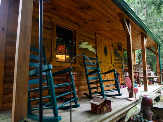 A mini cabin sits in the back yard at the home of Margie