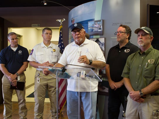 Port Aransas Mayor Charles Bujan speaks at the podium on Sept. 4 after meeting with FEMA and Texas Emergency Management officials about Hurricane Harvey damage.