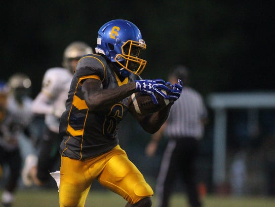 RIckards' Ferante Cowart hauls in a catch downfield.