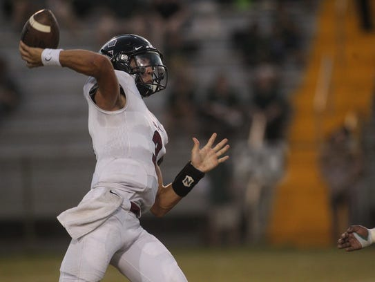 Chiles quarterback Garrett Greene throws a pass against
