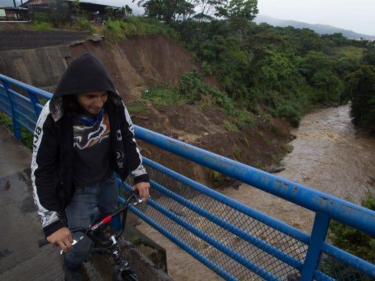 A cyclist rides over a bridge over the Maria Aguilar