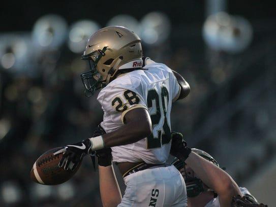 Lincoln's Caleb Matthews celebrates a touchdown run