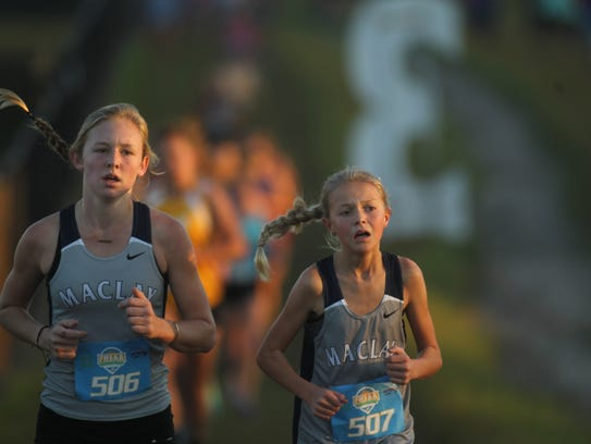 Maclay's Anna Lewis and Madeline Lilly run during Saturday's Region 1-1A meet at Oaks Equestrian Center in Lake City.