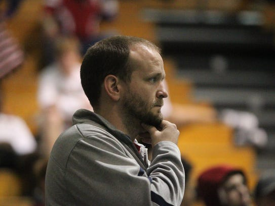 Wakulla coach Will Pafford watches his wrestlers at