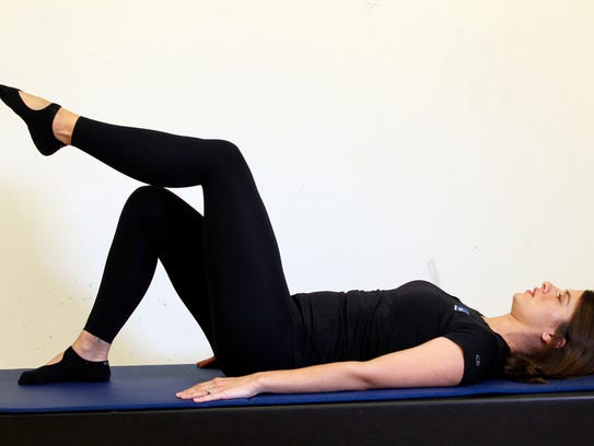 Erin Stern shows the ending position for the Pilates exercise, leg lift supine.