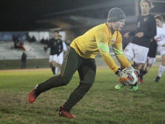 Florida High goalie Hayden Farrell makes a save against