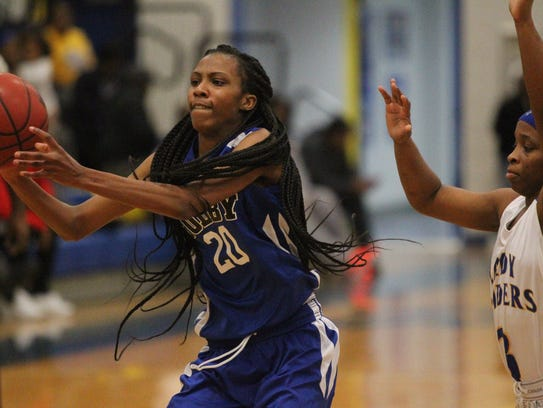 Godby sophomore Lashaydra Crumity makes a pass to the