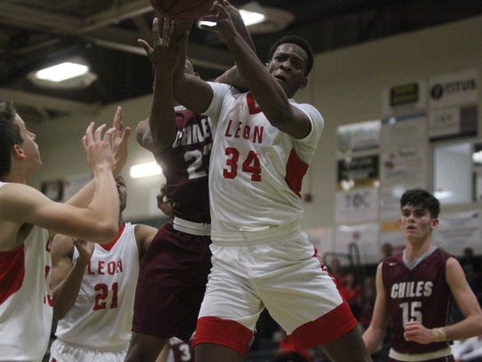 Leon's Jakari Gallon tries to get his hands on a rebound