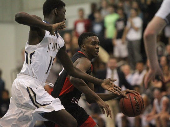 NFC's Jalan Black drives to the basket during a District
