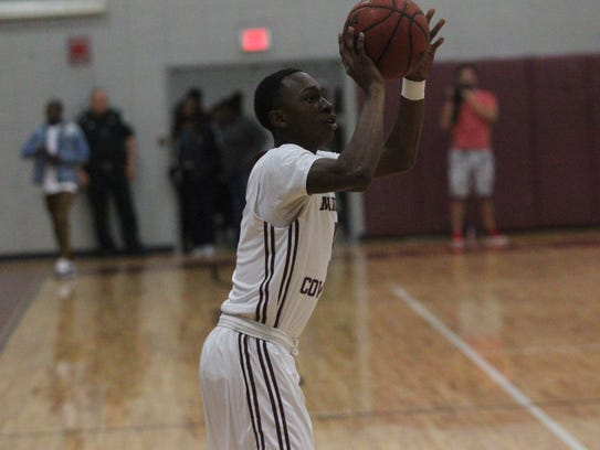 Madison County's Ken Hawkins nails a 3-pointer during