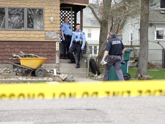 Lansing police on the scene of a death investigation