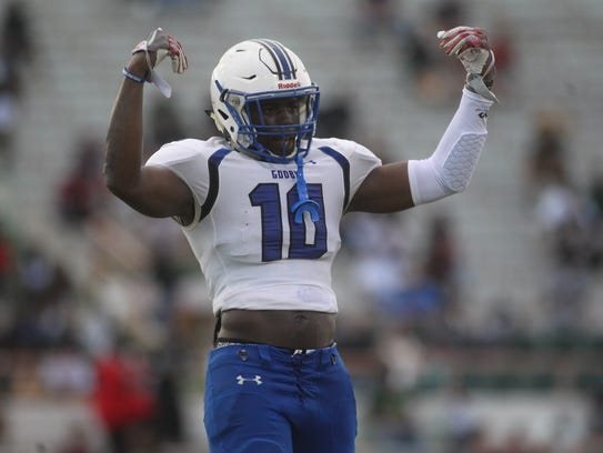 Godby's Cortez Andrews hypes up his team during Friday's