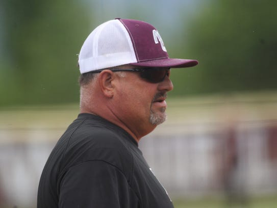 Madison County softball coach Tommy Garner and the