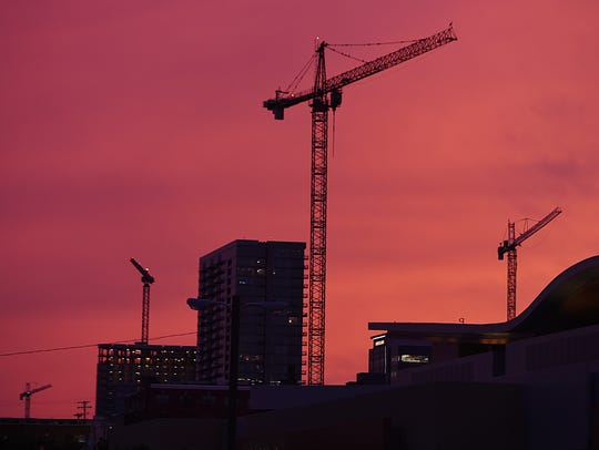 Construction cranes in downtown Nashville on July 15,
