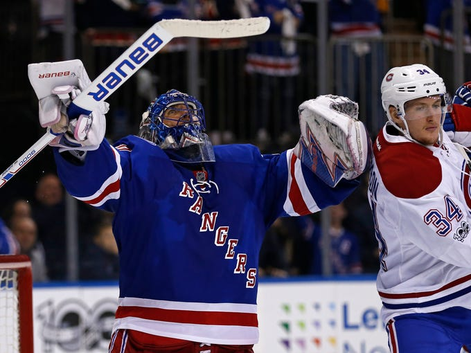 Rangers goalie Henrik Lundqvist (30) celebrates defeating 4fd683288