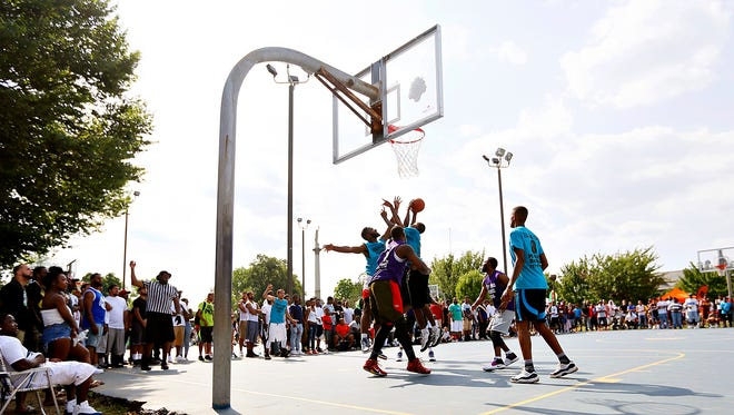 TeamCatchUp and Team Drew Wright compete during the Trey & Boo Classic Basketball Tournament at Penn Park in York City, Sunday, June 26, 2016. Dawn J. Sagert photo