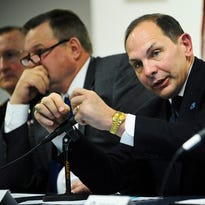Veterans Affairs Secretary Robert McDonald, right, addresses a member of the audience's on March 31 during a town hall meeting in which the secretary and Sen. Jon Tester, D-Mont., left, led a panel discussion at  the Montana National Guard headquarters in Helena, Mont.