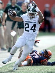 Michigan State running back Gerald Holmes (24) was the Spartans' second-leading rusher last season.