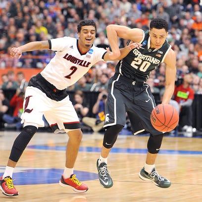 MSU's Travis Trice works the ball past Louisville's
