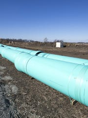 Pipes being laid on the Davis farm, Westfield.